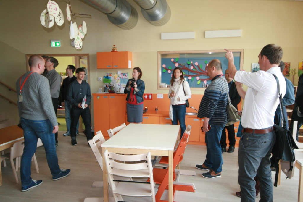 Visitor looking at a classroom in a Passive House Kindergarten