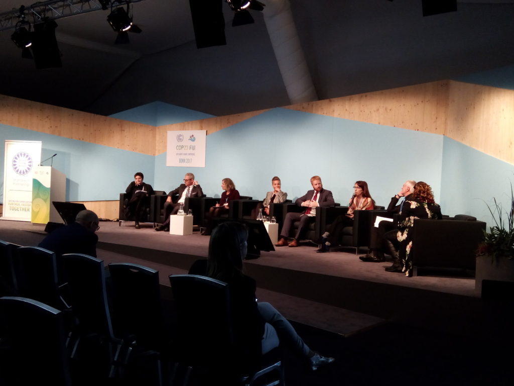 view from audience during podium discussion at COP23