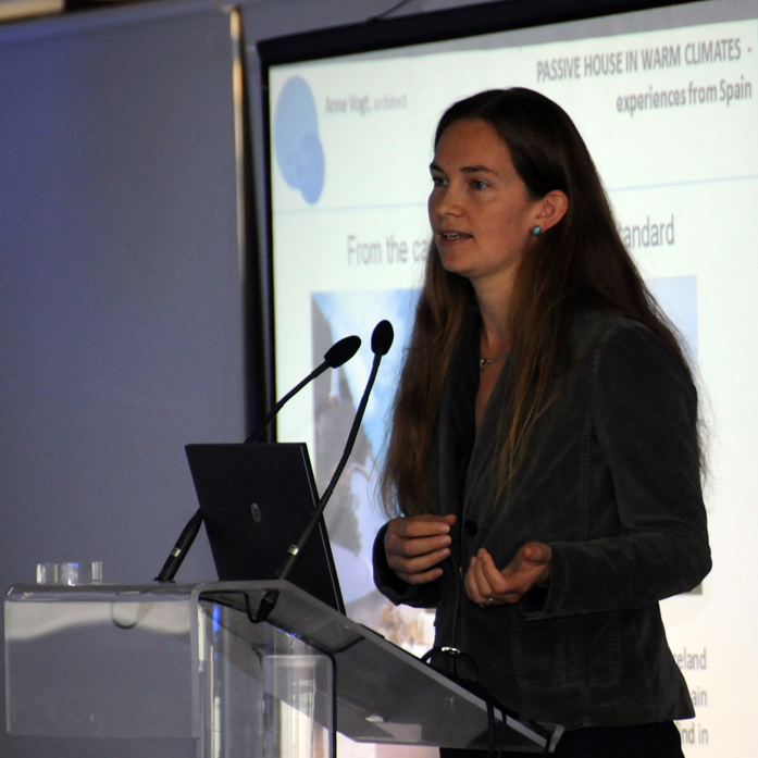 Image of Anne Vogt presenting on the Passive House Standard.
